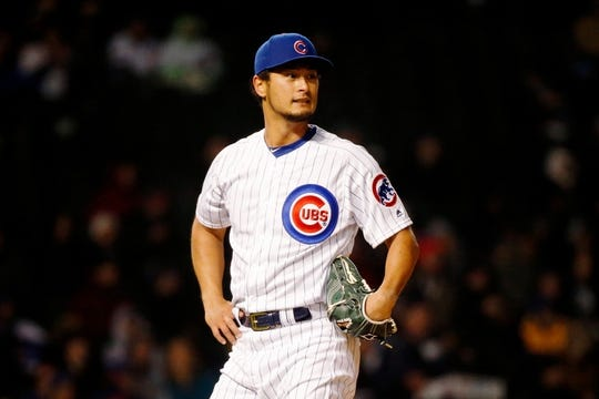 Apr 10, 2019; Chicago, IL, USA; Chicago Cubs starting pitcher Yu Darvish (11) reacts while waiting to see if right fielder Jason Heyward (not pictured) can make a catch against the Pittsburgh Pirates during the third inning at Wrigley Field. Mandatory Credit: Jon Durr-USA TODAY Sports