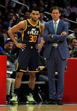 Apr 10, 2019; Los Angeles, CA, USA; Utah Jazz head coach Quin Snyder (right) talks with Jazz guard Naz Mitrou-Long (left) in the first half against the LA Clippers at Staples Center. Mandatory Credit: Kirby Lee-USA TODAY Sports