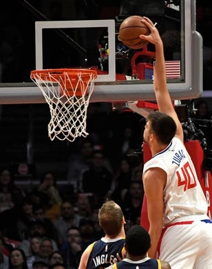 Apr 10, 2019; Los Angeles, CA, USA; LA Clippers center Ivica Zubac (40) dunks the ball past Utah Jazz forward Joe Ingles (2) in the first half at Staples Center. Mandatory Credit: Kirby Lee-USA TODAY Sports