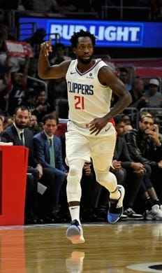 Apr 10, 2019; Los Angeles, CA, USA; LA Clippers guard Patrick Beverley (21) reacts after making a three point basket against the Utah Jazz in the first half at Staples Center. Mandatory Credit: Kirby Lee-USA TODAY Sports