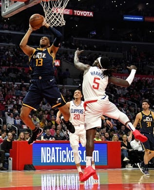 Apr 10, 2019; Los Angeles, CA, USA; Utah Jazz center Tony Bradley (13) drives to the basket past LA Clippers forward Montrezl Harrell (5) in the first half at Staples Center. Mandatory Credit: Kirby Lee-USA TODAY Sports