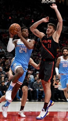Apr 10, 2019; Portland, OR, USA; Sacramento Kings guard Buddy Hield (24) shoots the ball as Portland Trail Blazers forward Meyers Leonard (11) defends during the first half of the game at the Moda Center. Mandatory Credit: Steve Dykes-USA TODAY Sports