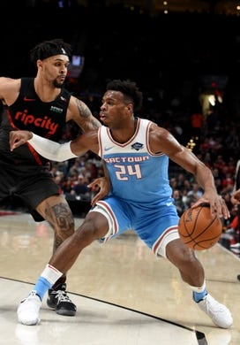 Apr 10, 2019; Portland, OR, USA; Sacramento Kings guard Buddy Hield (24) dribbles the ball as Portland Trail Blazers guard Gary Trent Jr. (9) defends during the first half of the game at the Moda Center. Mandatory Credit: Steve Dykes-USA TODAY Sports