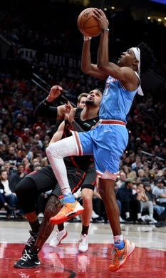 Apr 10, 2019; Portland, OR, USA; Sacramento Kings guard De'Aaron Fox (5) shoots the ball over Portland Trail Blazers guard Gary Trent Jr. (9) during the first half of the game at the Moda Center. Mandatory Credit: Steve Dykes-USA TODAY Sports