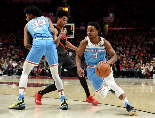 Apr 10, 2019; Portland, OR, USA; Sacramento Kings guard Yogi Ferrell (3) dribbles the ball around Kings Marvin Bagley III (35) as Portland Trail Blazers guard Anfernee Simons (24) chases during the first half of the game at the Moda Center. Mandatory Credit: Steve Dykes-USA TODAY Sports