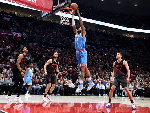 Apr 10, 2019; Portland, OR, USA; Sacramento Kings center Willie Cauley-Stein (00) dunks the ball as Portland Trail Blazers forward Skal Labissiere (17) and forward Jake Layman (10) and forward Meyers Leonard (11) look on during the first half of the game at the Moda Center. Mandatory Credit: Steve Dykes-USA TODAY Sports