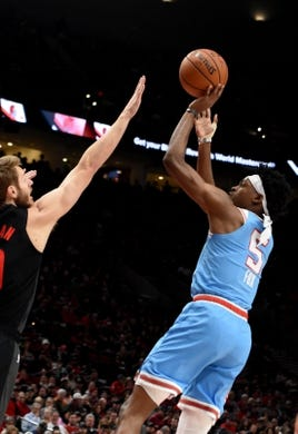 Apr 10, 2019; Portland, OR, USA; Sacramento Kings guard De'Aaron Fox (5) shoots the ball over Portland Trail Blazers forward Jake Layman (10) during the first half of the game at the Moda Center. Mandatory Credit: Steve Dykes-USA TODAY Sports