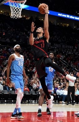 Apr 10, 2019; Portland, OR, USA; Portland Trail Blazers forward Skal Labissiere (17) drives to the basket on Sacramento Kings guard Corey Brewer (33) and forward Caleb Swanigan (50)during the second half of the game at the Moda Center. The Blazers won 136-131. Mandatory Credit: Steve Dykes-USA TODAY Sports