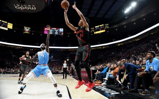 Apr 10, 2019; Portland, OR, USA; Portland Trail Blazers guard Anfernee Simons (24) hits a shot over Sacramento Kings forward BJ Johnson (9) during the second half of the game at the Moda Center. The Blazers won 136-131. Mandatory Credit: Steve Dykes-USA TODAY Sports