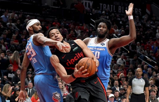 Apr 10, 2019; Portland, OR, USA; Portland Trail Blazers forward Skal Labissiere (17) drives to the basket past Sacramento Kings guard Corey Brewer (33) and forward Caleb Swanigan (50) during the second half of the game at the Moda Center. The Blazers won 136-131. Mandatory Credit: Steve Dykes-USA TODAY Sports