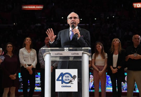 Apr 10, 2019; Los Angeles, CA, USA;  LA Clippers broadcaster Ralph Lawler speaks at a halftime ceremony to recognize his final regular season game after 40 yearsf at Staples Center. Mandatory Credit: Kirby Lee-USA TODAY Sports