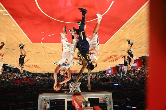 Apr 10, 2019; Los Angeles, CA, USA; LA Clippers forward Danilo Gallinari (8) is defended by Utah Jazz center Ekpe Udoh (33)  in the second half at Staples Center. The Clippers defeated the Jazz 143-137. Mandatory Credit: Kirby Lee-USA TODAY Sports