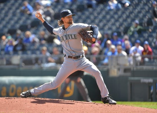 Apr 11, 2019; Kansas City, MO, USA; Seattle Mariners starting pitcher Mike Leake (8) delivers a pitch in the first inning against the Kansas City Royals at Kauffman Stadium. Mandatory Credit: Denny Medley-USA TODAY Sports
