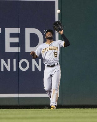 Apr 12, 2019; Washington, DC, USA; Pittsburgh Pirates center fielder Starling Marte (6) catches a fly ball during the first inning against the Washington Nationals at Nationals Park. Mandatory Credit: Gregory J. Fisher-USA TODAY Sports