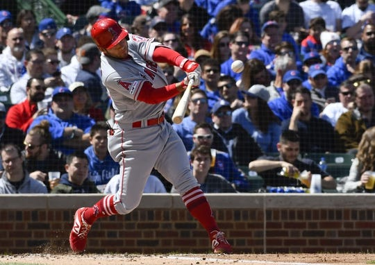 Apr 13, 2019; Chicago, IL, USA; Los Angeles Angels shortstop David Fletcher (6) hits an RBI single against the Chicago Cubs in the first inning at Wrigley Field. Mandatory Credit: Matt Marton-USA TODAY Sports