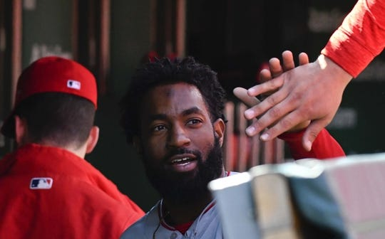 Apr 13, 2019; Chicago, IL, USA; Los Angeles Angels center fielder Brian Goodwin (18) celebrates in the dugout after scoring against the Chicago Cubs in the second inning at Wrigley Field. Mandatory Credit: Matt Marton-USA TODAY Sports