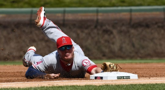 Apr 13, 2019; Chicago, IL, USA; Los Angeles Angels first baseman Justin Bour (41) dives back to first base tagging Chicago Cubs first baseman Anthony Rizzo (44) out in the first inning at Wrigley Field. Mandatory Credit: Matt Marton-USA TODAY Sports