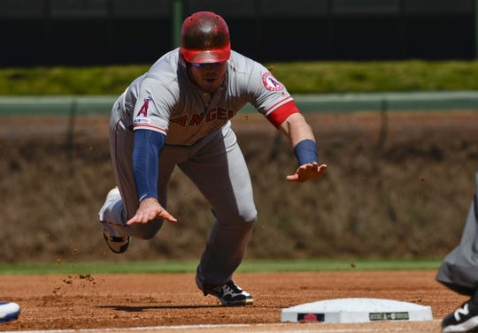 Apr 13, 2019; Chicago, IL, USA; Los Angeles Angels first baseman Justin Bour (41) dives back to first base against the Chicago Cubs in the first inning at Wrigley Field. Mandatory Credit: Matt Marton-USA TODAY Sports