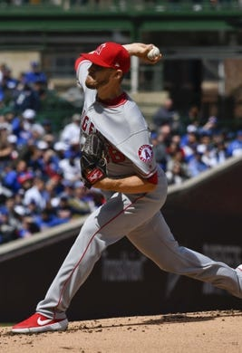 Apr 13, 2019; Chicago, IL, USA; Los Angeles Angels starting pitcher Chris Stratton (36) delivers against the Chicago Cubs in the first inning at Wrigley Field. Mandatory Credit: Matt Marton-USA TODAY Sports