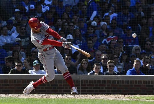 Apr 13, 2019; Chicago, IL, USA; Los Angeles Angels third baseman Zack Cozart (7) hits a single against the Chicago Cubs in the fourth inning at Wrigley Field. Mandatory Credit: Matt Marton-USA TODAY Sports