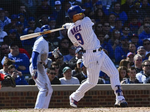 Apr 13, 2019; Chicago, IL, USA; Chicago Cubs shortstop Javier Baez (9) hits an RBI double against the Los Angeles Angels in the fifth inning at Wrigley Field. Mandatory Credit: Matt Marton-USA TODAY Sports