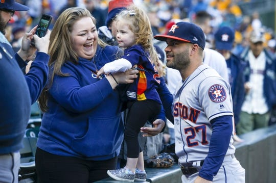 Apr 13, 2019; Seattle, WA, USA; Houston Astros second baseman Jose Altuve (27) poses for a photo with fans before a game against the Seattle Mariners at T-Mobile Park. Mandatory Credit: Joe Nicholson-USA TODAY Sports