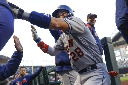 Apr 13, 2019; Seattle, WA, USA; Houston Astros catcher Robinson Chirinos (28) celebrates in the dugout after hitting a solo-home run against the Seattle Mariners during the third inning at T-Mobile Park. Mandatory Credit: Joe Nicholson-USA TODAY Sports