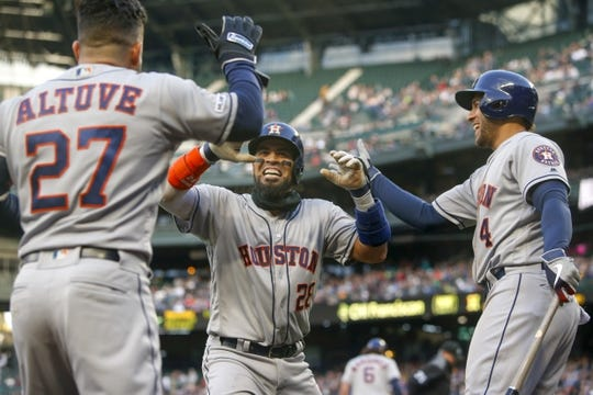 Apr 13, 2019; Seattle, WA, USA; Houston Astros catcher Robinson Chirinos (28) celebrates with right fielder George Springer (4) outside the dugout after hitting a solo-home run against the Seattle Mariners during the third inning at T-Mobile Park. Mandatory Credit: Joe Nicholson-USA TODAY Sports