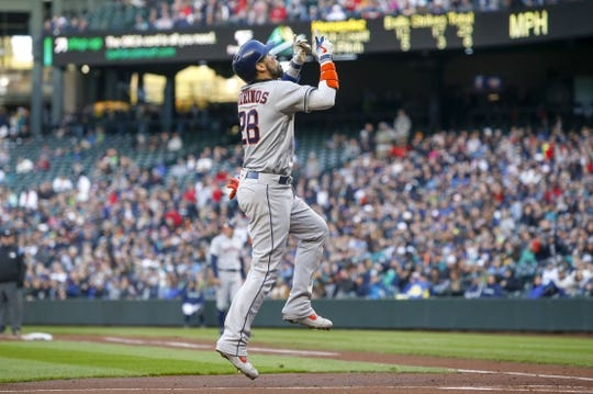 Apr 13, 2019; Seattle, WA, USA; Houston Astros catcher Robinson Chirinos (28) reacts after hitting a solo-home run against the Seattle Mariners during the third inning at T-Mobile Park. Mandatory Credit: Joe Nicholson-USA TODAY Sportsf