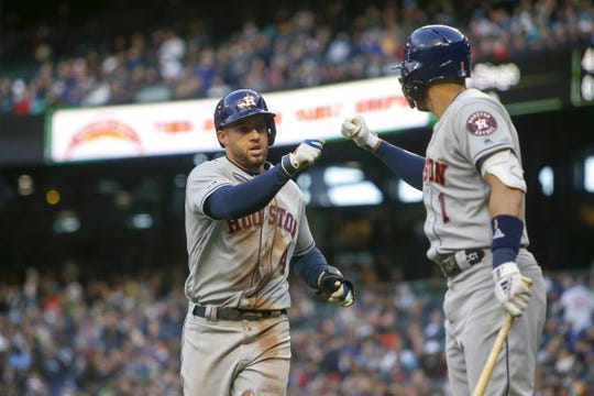 Apr 13, 2019; Seattle, WA, USA; Houston Astros right fielder George Springer (4) is greeted outside the dugout after scoring a run against the Seattle Mariners during the third inning at T-Mobile Park. Mandatory Credit: Joe Nicholson-USA TODAY Sports