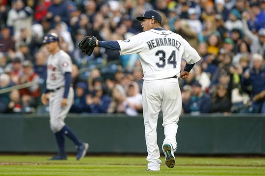 Apr 13, 2019; Seattle, WA, USA; Seattle Mariners starting pitcher Felix Hernandez (34) reacts following a double play to end the fourth inning against the Houston Astros at T-Mobile Park. Mandatory Credit: Joe Nicholson-USA TODAY Sports