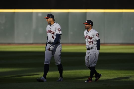 Apr 13, 2019; Seattle, WA, USA; Houston Astros right fielder George Springer (4) and second baseman Jose Altuve (27) walk in the outfield before a game against the Seattle Mariners at T-Mobile Park. Mandatory Credit: Joe Nicholson-USA TODAY Sports