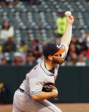 Apr 17, 2019; Oakland, CA, USA; Houston Astros starting pitcher Wade Miley (20) pitches the ball against the Oakland Athletics during the first inning at Oakland Coliseum. Mandatory Credit: Kelley L Cox-USA TODAY Sports