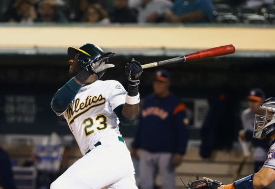 Apr 17, 2019; Oakland, CA, USA; Oakland Athletics second baseman Jurickson Profar (23) hits a single against the Houston Astros during the fifth inning at Oakland Coliseum. Mandatory Credit: Kelley L Cox-USA TODAY Sports