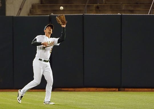 Apr 17, 2019; Oakland, CA, USA; Oakland Athletics right fielder Stephen Piscotty (25) catches the ball against the Houston Astros during the fifth inning at Oakland Coliseum. Mandatory Credit: Kelley L Cox-USA TODAY Sports