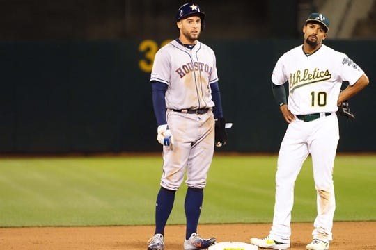 Apr 17, 2019; Oakland, CA, USA; Oakland Athletics shortstop Marcus Semien (10) reacts after Houston Astros designated hitter George Springer (4) stole second base during the sixth inning at Oakland Coliseum. Mandatory Credit: Kelley L Cox-USA TODAY Sports