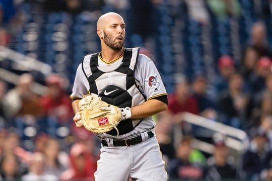 Apr 12, 2019; Washington, DC, USA; Pittsburgh Pirates catcher Jacob Stallings (58) looks back a runner during the second inning against the Washington Nationals at Nationals Park. Mandatory Credit: Gregory J. Fisher-USA TODAY Sports