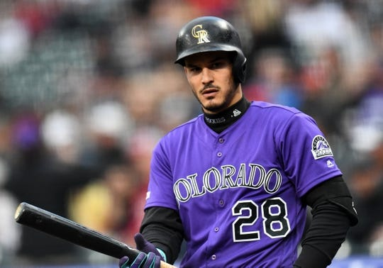 Apr 18, 2019; Denver, CO, USA; Colorado Rockies third baseman Nolan Arenado (28) on deck in the first inning against the Philadelphia Phillies at Coors Field. Mandatory Credit: Ron Chenoy-USA TODAY Sports
