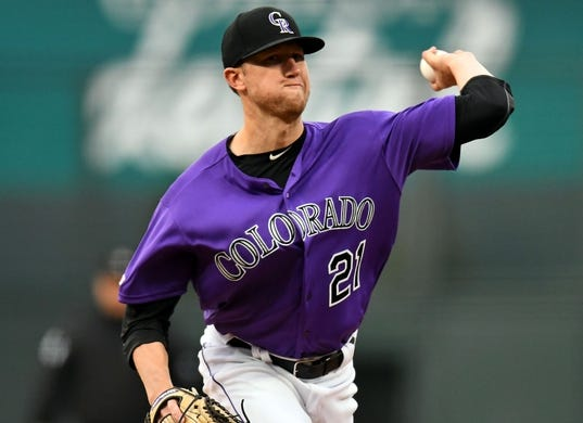Apr 18, 2019; Denver, CO, USA; Colorado Rockies starting pitcher Kyle Freeland (21) delivers a pitch in the first inning against the Philadelphia Phillies at Coors Field. Mandatory Credit: Ron Chenoy-USA TODAY Sports