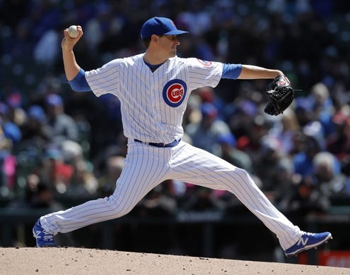 Apr 19, 2019; Chicago, IL, USA; Chicago Cubs starting pitcher Kyle Hendricks (28) pitches against the Arizona Diamondbacks during the first inning at Wrigley Field. Mandatory Credit: Jim Young-USA TODAY Sports
