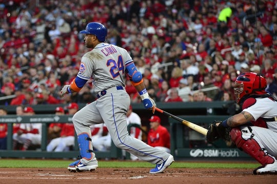Apr 19, 2019; St. Louis, MO, USA; New York Mets second baseman Robinson Cano (24) hits a double off of St. Louis Cardinals starting pitcher Adam Wainwright (not pictured) during the first inning at Busch Stadium. Mandatory Credit: Jeff Curry-USA TODAY Sports