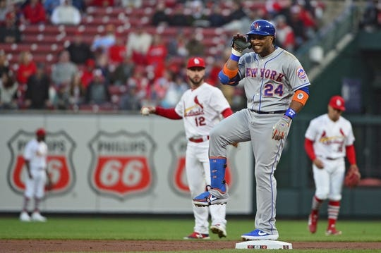 Apr 19, 2019; St. Louis, MO, USA; New York Mets second baseman Robinson Cano (24) celebrates after hitting a double off of St. Louis Cardinals starting pitcher Adam Wainwright (not pictured) during the first inning at Busch Stadium. Mandatory Credit: Jeff Curry-USA TODAY Sports