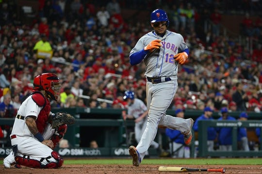 Apr 19, 2019; St. Louis, MO, USA; New York Mets center fielder Juan Lagares (12) scores on a single by second baseman Robinson Cano (not pictured) during the second inning against the St. Louis Cardinals at Busch Stadium. Mandatory Credit: Jeff Curry-USA TODAY Sports