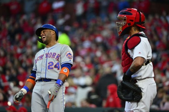Apr 19, 2019; St. Louis, MO, USA; New York Mets second baseman Robinson Cano (24) talks with St. Louis Cardinals catcher Yadier Molina (4) during the first inning at Busch Stadium. Mandatory Credit: Jeff Curry-USA TODAY Sports