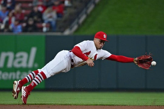 Apr 19, 2019; St. Louis, MO, USA; St. Louis Cardinals catcher Yadier Molina (4) dives for a single hit by New York Mets center fielder Juan Lagares (not pictured) during the second inning at Busch Stadium. Mandatory Credit: Jeff Curry-USA TODAY Sports