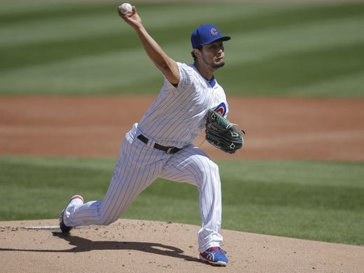 Apr 20, 2019; Chicago, IL, USA; Chicago Cubs starting pitcher Yu Darvish (11) pitches against the Arizona Diamondbacks during the first inning at Wrigley Field. Mandatory Credit: Jim Young-USA TODAY Sports