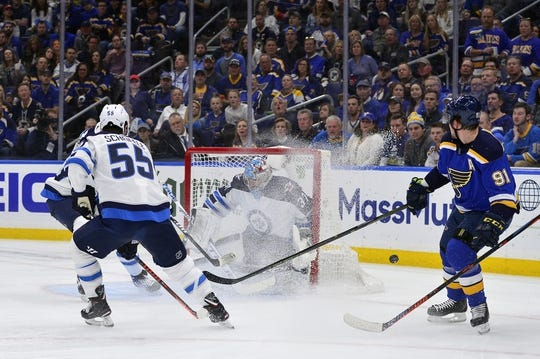 Apr 20, 2019; St. Louis, MO, USA; Winnipeg Jets goaltender Connor Hellebuyck (37) defends the net against St. Louis Blues right wing Vladimir Tarasenko (91) during the first period in game six of the first round of the 2019 Stanley Cup Playoffs at Enterprise Center. Mandatory Credit: Jeff Curry-USA TODAY Sports