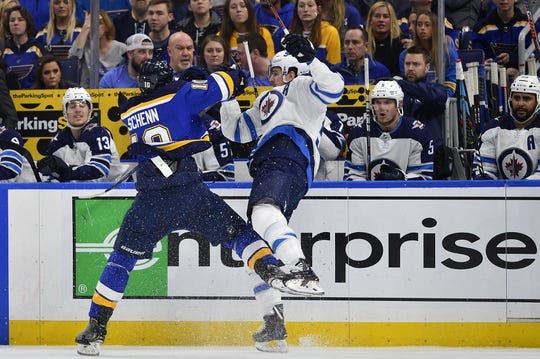 Apr 20, 2019; St. Louis, MO, USA; St. Louis Blues center Brayden Schenn (10) checks Winnipeg Jets center Mark Scheifele (55) during the first period in game six of the first round of the 2019 Stanley Cup Playoffs at Enterprise Center. Mandatory Credit: Jeff Curry-USA TODAY Sports