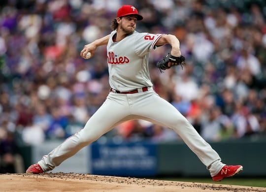 Apr 20, 2019; Denver, CO, USA; Philadelphia Phillies starting pitcher Aaron Nola (27) pitches in the first inning against the Colorado Rockies at Coors Field. Mandatory Credit: Isaiah J. Downing-USA TODAY Sports