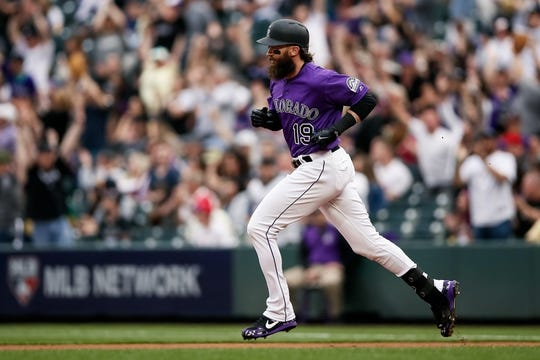 Apr 20, 2019; Denver, CO, USA; Colorado Rockies right fielder Charlie Blackmon (19) rounds the bases on a solo home run in the first inning against the Philadelphia Phillies at Coors Field. Mandatory Credit: Isaiah J. Downing-USA TODAY Sports